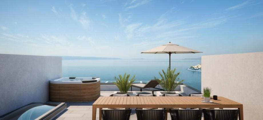 Exclusif! A vendre appartement duplex avec terrasse sur le toit! Vue mer panoramique!